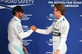 Lewis Hamilton (GBR) Mercedes AMG F1 and pole sitter Nico Rosberg (GER) Mercedes AMG F1 celebrate in parc ferme.