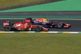 Kimi Raikkonen (FIN) Ferrari F14 T and Sebastian Vettel (GER) Red Bull Racing RB10 battle.