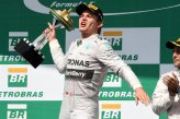 Race winner Nico Rosberg (GER) Mercedes AMG F1 celebrates on the podium with the trophy.