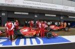 Ferrari mechanics with Ferrari F14 T in pit lane. Formula One World Championship, Rd9, British Grand Prix, Qualifying, Silverstone, England, Saturday, 5 July 2014