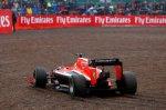 Jules Bianchi (FRA) Marussia F1 Team MR03 takes a trip through the gravel. Formula One World Championship, Rd9, British Grand Prix, Qualifying, Silverstone, England, Saturday, 5 July 2014