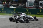 Kevin Magnussen (DEN) McLaren MP4-29 and Felipe Massa (BRA) Williams FW36 battle.