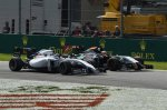Valtteri Bottas (FIN) Williams FW36 and Nico Hulkenberg (GER) Force India VJM07 battle.