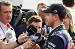 Sebastian Vettel (GER) Red Bull Racing talks with Craig Slater (GBR) Sky TV and the media.