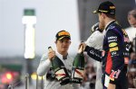 Nico Rosberg (GER) Mercedes AMG F1 and Sebastian Vettel (GER) Red Bull Racing with the champagne on the podium.
