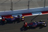 Daniil Kvyat (RUS) Scuderia Toro Rosso STR9 and Sebastian Vettel (GER) Red Bull Racing RB10.