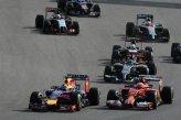 Daniel Ricciardo (AUS) Red Bull Racing RB10 and Kimi Raikkonen (FIN) Ferrari F14 T battle at the start of the race.