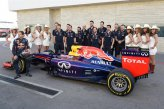 Sebastian Vettel (GER) Red Bull Racing RB10 with his engineers and grid girls.